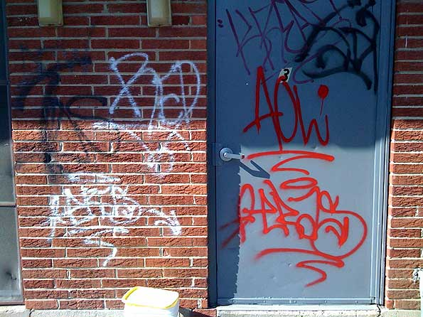 graffiti-on-doors-brick
