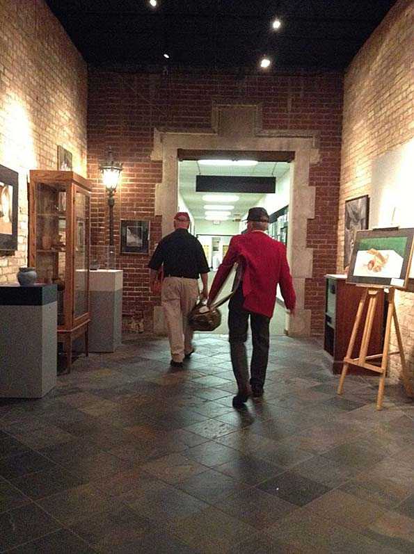 Russ Attis and Bob Frisk leaving the former Arlington High School's while walking in the school's east hallway
