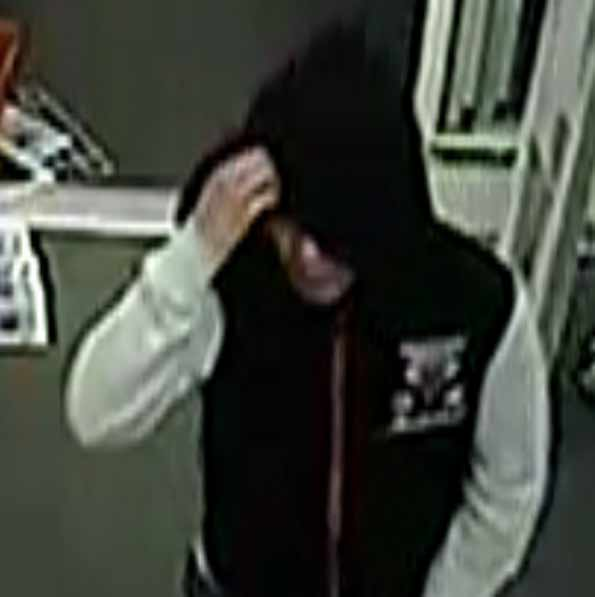 CVS robbery suspect black Bulls hoodie with white sleeves.