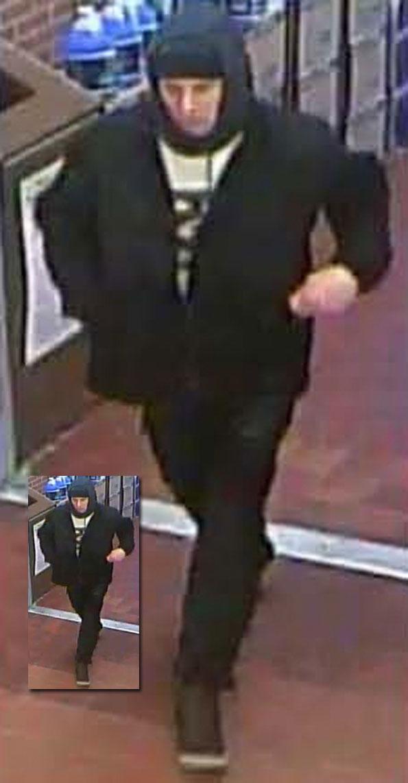 Suspect 1 (surveillance image).