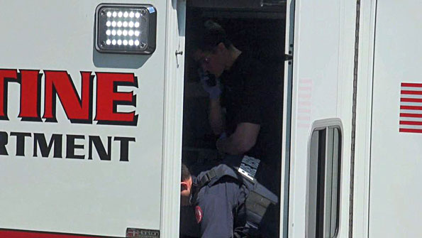 Shooting victim with paramedics in Palatine Fire Ambulance