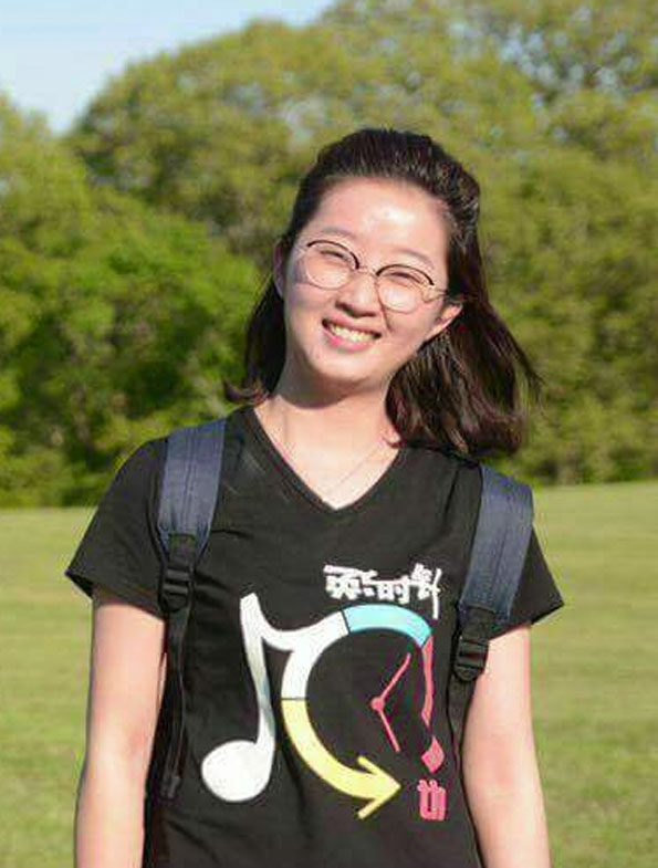 Yingying Zhang backpack black shirt