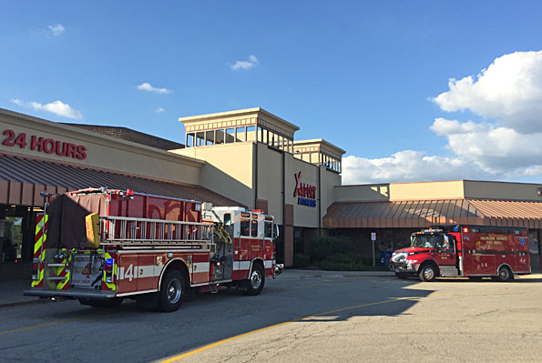 Engine 4 and Ambulance 4 at an Emergency Medical Service call at a fitness center in Arlington Heights District 4.