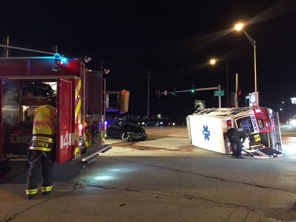 Arlington Heights Engine 4 at a private ambulance rollover crash at Dundee Road and Arlington Heights Road in District 4