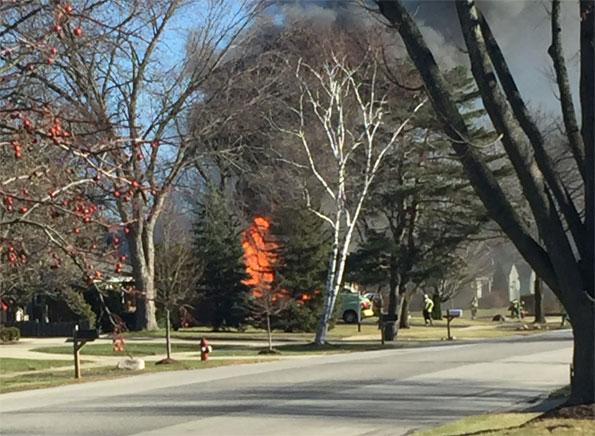 Garage Fire extending to house fire Arlington Heights
