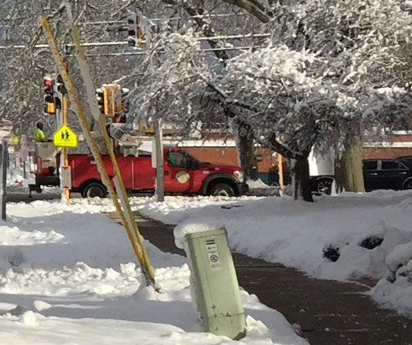 Arlington Heights Public Works crew clearing Olive Street Traffic Signal