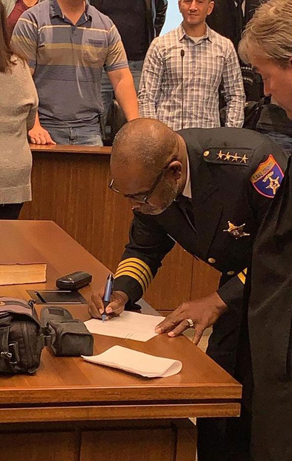 Sheriff John Idleburg signing