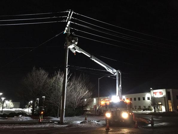 ComEd crew repairing power equipment on Kennicott Avenue in Arlington Heights