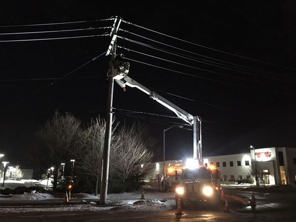ComEd crew repairing power equipment on Kennicott Avenue in Arlington Heights