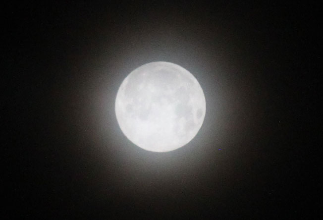 Snow Moon SuperMoon with thin cloud veil at 5:30 a.m. Tuesday, February 19, 2019
