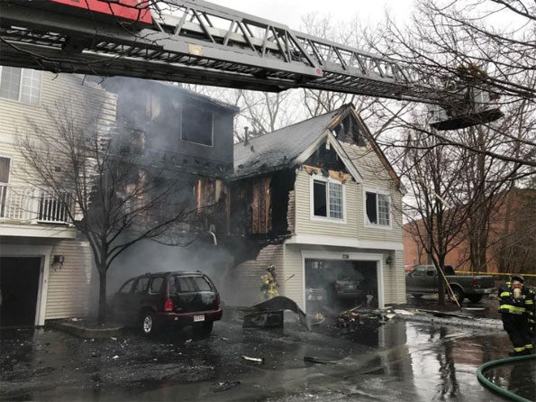 Wheeling townhouse fire caused by car fire