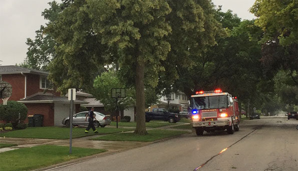 Arlington Heights fire engine on Rammer for downed power line