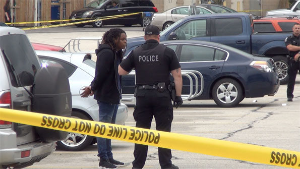 Person in handcuffs at Rolling Meadows shooting scene