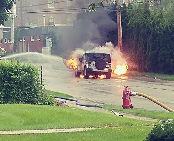 Jeep on fire after being ignited from radiant heat of gas flame out of ground