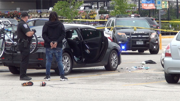 Male in handcuffs at Rolling Meadows shooting scene