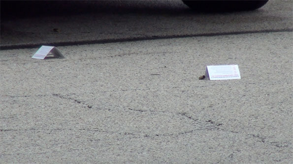 Shell casings and markers at Rolling Meadows Walmart shooting scene