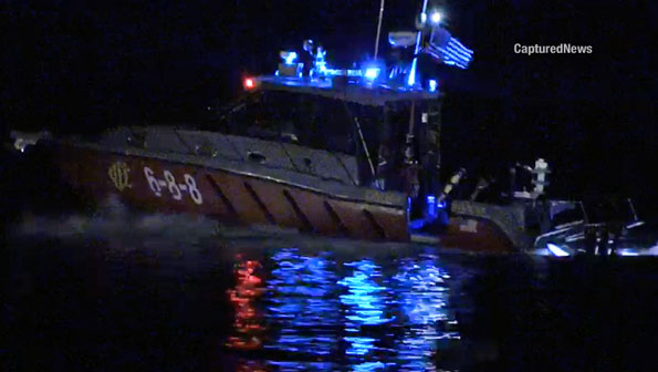 Chicago Fire Department Fast Boat 6-8-8 rushing victim to Belmont Harbor dock after boat capsized