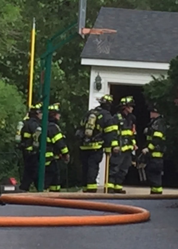 Firefighters at small detached garage fire Arlington Heights