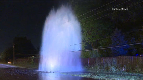 Water main geyser into power lines in Arlington Heights
