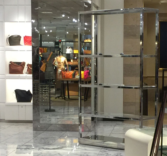 Handbag rack Nordstrom Woodfield where thousands of dollars in handbags taken in Flash Mob Robbery