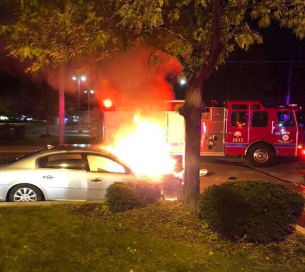 Car vs pole fire with police rescue in Zion