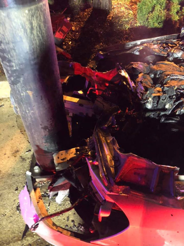 Car vs pole crash damage involved with police rescue in Zion