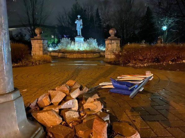 Bricks piled by William H. Dunton statue