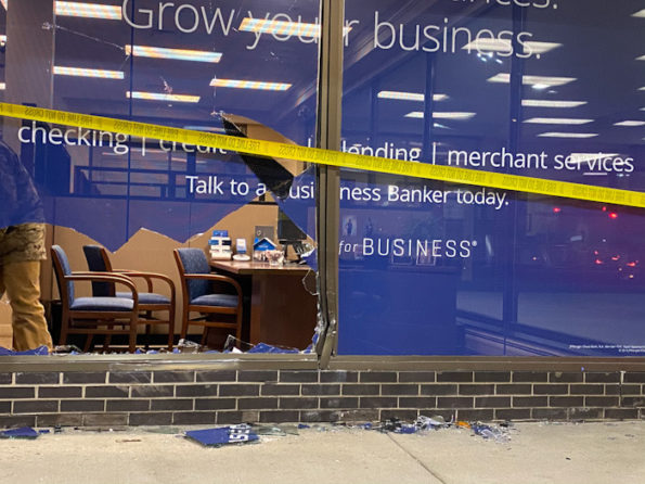Clean up after vehicle crash into Chase bank window in Arlington Heights