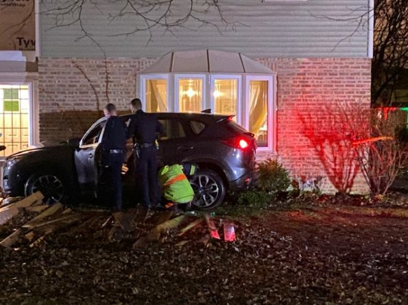 SUV crash against house at Newbury Lane and Grove Street in Scarsdale, Arlington Heights