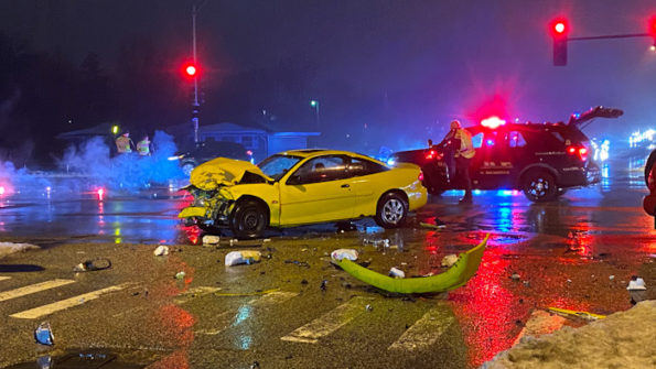 The yellow Chevrolet Cavalier after a head-on crash at Arlington Heights Road and Hintz Road