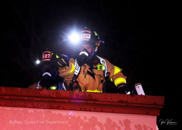 Buffalo Grove firefighters with headlamps on the roof (SOURCE: BGFD/J Kleeman)