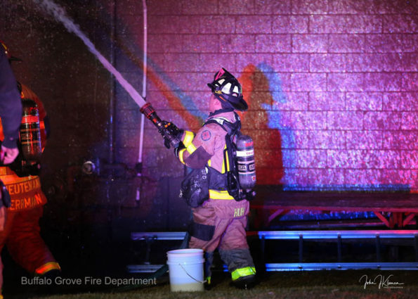 Firefighter with handline at Dengeos restaurant fire (SOURCE: BGFD/J Kleeman)