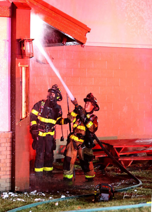 Handline attack at soffit at Dengeos fire Sunday January 5, 2010 (SOURCE: BGFD/J Kleeman)