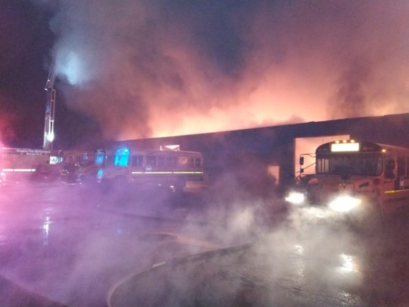 School buses exposed near vacant warehouse fire on Vincennes near 85th Street Chicago (SOURCE: CFD Media)