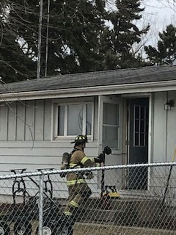 Firefighter entering house fire scene on Main Street, Antioch Thursday March 5, 2020 (SOURCE: Antioch Fire Department)