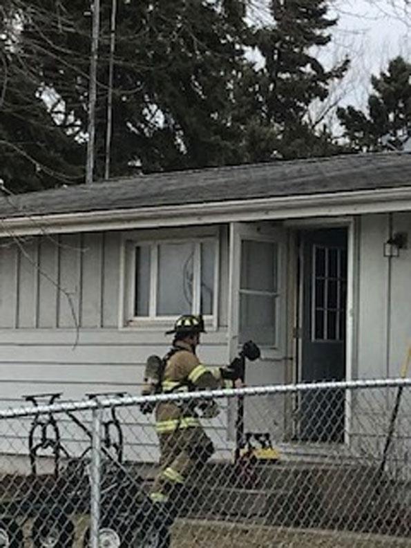 Firefighter entering house fire scene on Main Street, Antioch Thursday March 5, 2020 (SOURCE: Antioch Fire Department)