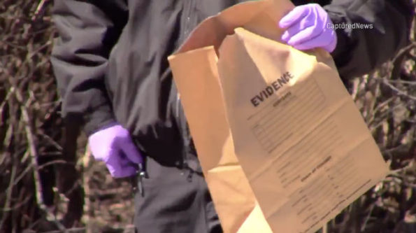 Evidence Bag with forensics investigators  at the crime scene on Old Sutton Road Barrington Hills on Saturday, March 7, 2020