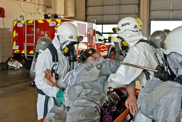 Illinois Army National Guard soldiers practice decontamination procedures while in protective gear during an exercise at the 182nd Airlift Wing in Peoria, Illinois