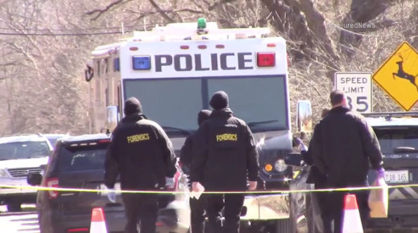 Forensics investigators return to the MCAT van at the crime scene on Old Sutton Road Barrington Hills on Saturday, March 7, 2020