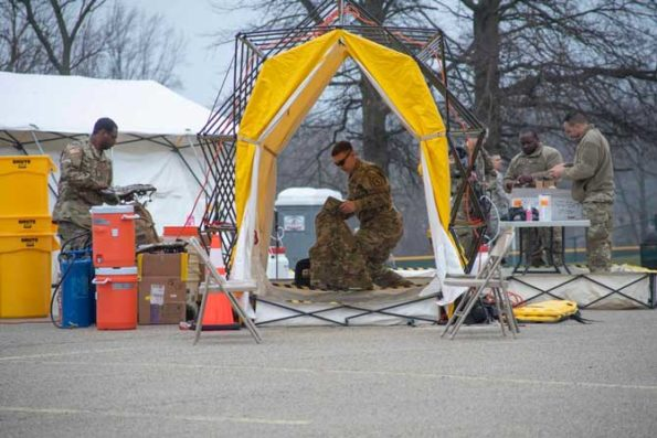 Pennsylvania Air National Guardsmen set up gear at a mass coronavirus test center in Upper Dublin Township, Pa., March 20, 2020. Approximately 80 members worked with local, state and federal authorities to open the drive-thru testing location