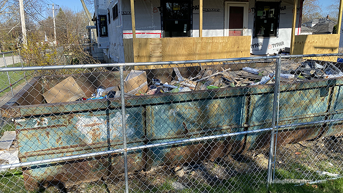 Illegal dumping at residential construction site dumpster