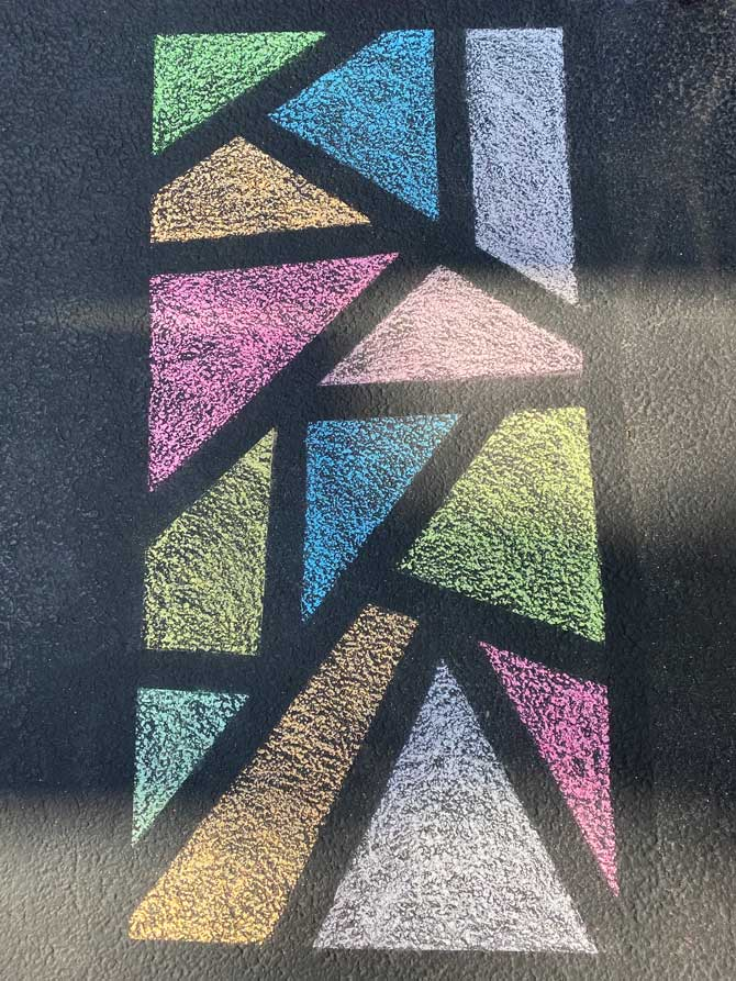 Chalked Stained Glass art on driveway in Arlington Heights