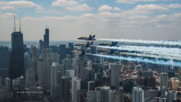 Blue Angels fly by the Chicago skyline