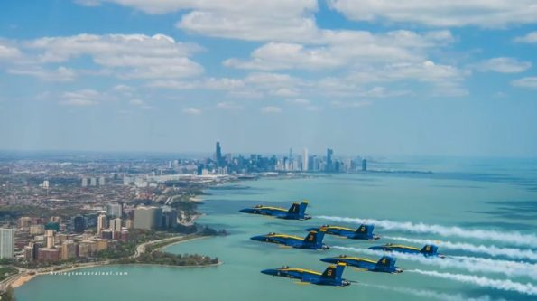 Blue Angels in formation in front of skyline
