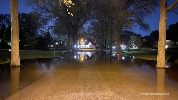 Flooded street and yards on Rollings Lane near Euclid Avenue in Arlington Heights