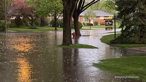 Flooded street on Lynnwood Avenue near Thomas Street in Arlington Heights