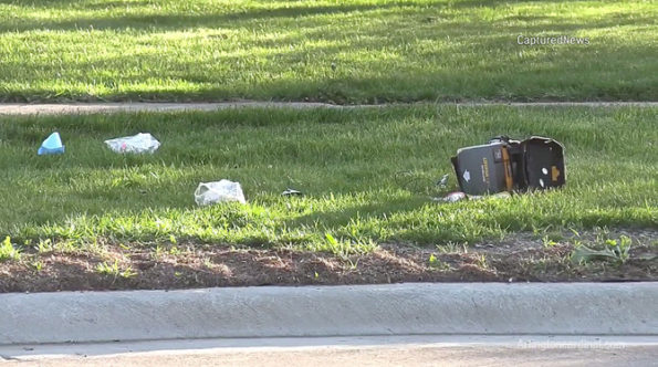 Defibrillator and used medical supplies at scene where gunshot victim was treated
