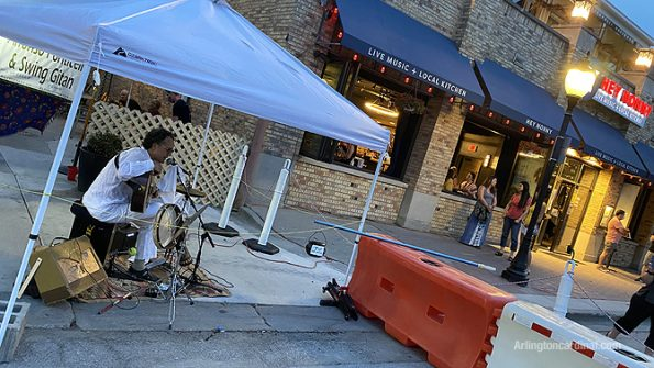 Outdoor entertainment in front of Hey Nonny  on Vail Avenue, Arlington Heights