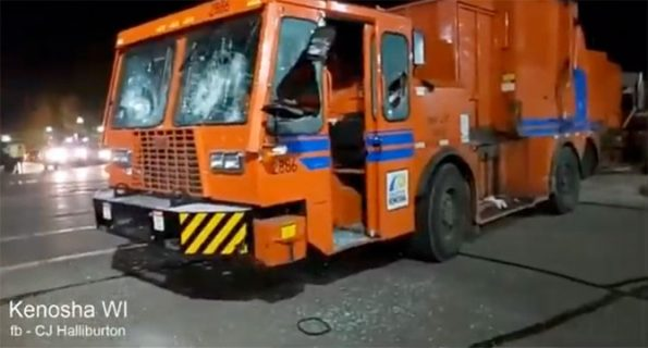 Garbage truck with broken windshield just before it was set on fire (SOURCE: CJ Halliburton)