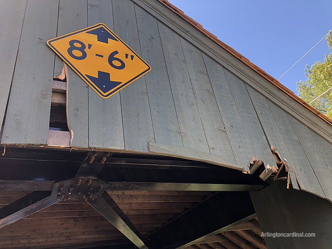 Damage to wood planks on the covered bridge in Long Grove